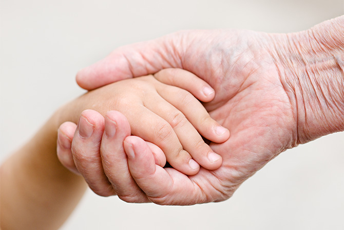 arthritis young old holding hands