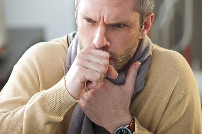 bronchitis man coughing